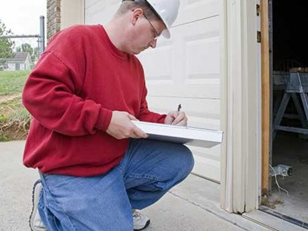 Home inspector checking entryways
